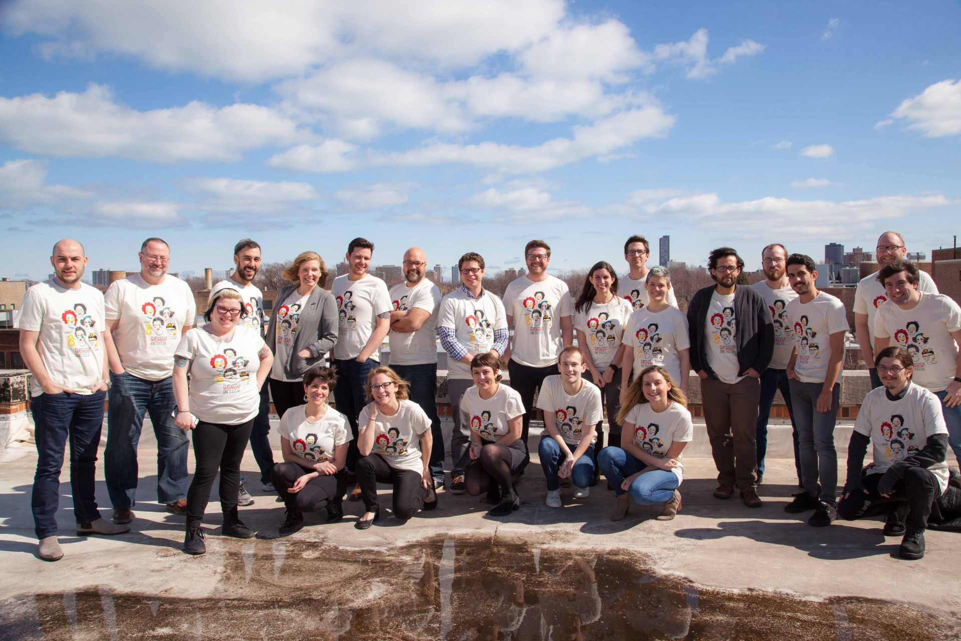 NeonCRM staff photo of our women in tech shirt. We're proud to be following in the footsteps of these inspiring women!
